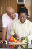 Husband And Wife Preparing A Meal Together Royalty Free Stock Image