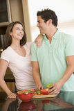 Husband And Wife Preparing A Meal Together Stock Photography