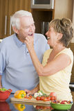 Husband And Wife Preparing Vegetables Royalty Free Stock Photography