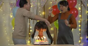 Little girl is sad because of her parents quarrelling in her birthday party. stock video footage