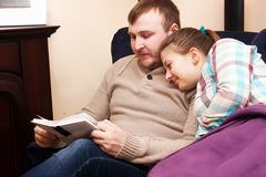 Husband and wife reading book Royalty Free Stock Image