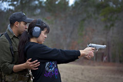 Husband and Wife Shooting Lesson Stock Images