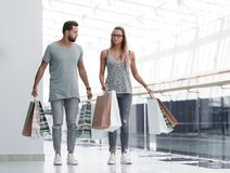 Husband and wife with shopping bags go together royalty free stock image