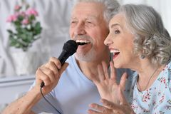Husband and wife singing songs. Senior couple husband and wife singing songs royalty free stock photo