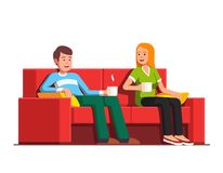 Husband and wife siting on sofa drinking tea. Family husband and wife relaxing together. People man and woman siting on sofa drinking tea or coffee. Home living Stock Images