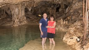 Husband and wife in a small cenote near Akumal Stock Photos