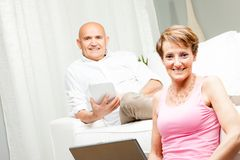 Husband and wife spending a relaxing day at home Stock Images