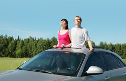 Husband, wife stand in hatch of car Stock Photos