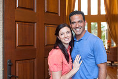 Husband and wife standing in entrance of home Stock Photography
