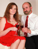 A Husband and Wife Toast with Red Wine Stock Photos