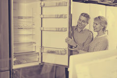 Husband and wife together in shop of household appliances Stock Photography