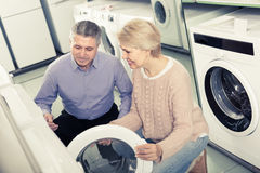Husband and wife together in shop of household appliances Royalty Free Stock Photo