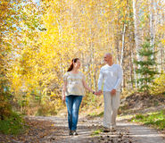 Husband and wife walk in autumn forest Stock Photo