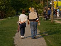 Husband And Wife Walking. Casual dressed husband and wife walking in the park Royalty Free Stock Photography