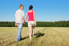 Husband, wife walking in beautiful field Royalty Free Stock Image