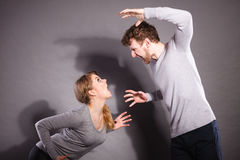 Husband and wife yelling and arguing. Stock Photo