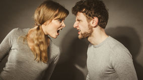 Husband and wife yelling and arguing. Royalty Free Stock Photos
