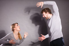 Husband and wife yelling and arguing. Royalty Free Stock Photography