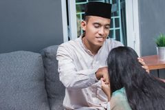 Forgiving and apologizing each other. eid mubarak. Husband and wive during muslim eid mubarak celebration. forgiving and apologizing each other royalty free stock photography