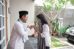 Forgiving and apologizing each other. eid mubarak. Husband and wive during muslim eid mubarak celebration. forgiving and apologizing each other stock photography