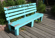 Husbands Waiting Area Bench. Bench painted to reflect a waiting area for husband while wives are shopping Royalty Free Stock Photography