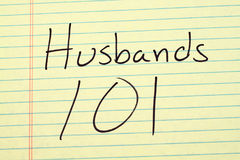 Husbands 101 On A Yellow Legal Pad. The words `Husbands 101` on a yellow legal pad Stock Photos