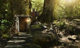 Husdvärgar och älvor i en magisk skog Arkivbild