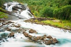 Husedalen - dal av vattenfall Norge Slingan Arkivfoton