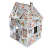 Huset gjorde gjort av engelska 10 pund och små pengar Royaltyfri Fotografi