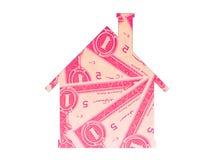 Huset intecknar fastighetsymbolspengar arkivbilder