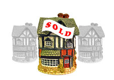 Husfastighetsmarknaden sålde tecknet Arkivfoton