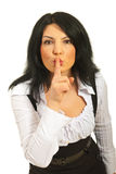 Hush! Be quiet!. Business woman request to be quiet and gesturing isolated on white background Royalty Free Stock Photography