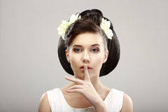 Hush! Beautiful Young Woman showing Silence Sign with her Forefinger. Warning Royalty Free Stock Photo