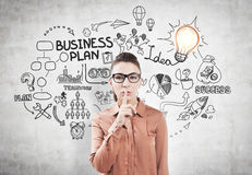 Hush girl in glasses and a business plan idea Royalty Free Stock Images