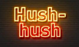 Hush-hush neon sign on brick wall background. Hush-hish neon sign on brick wall background Stock Photos