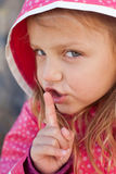Hush.it's a secret. Little girl with a secret making shh gesture Royalty Free Stock Photos