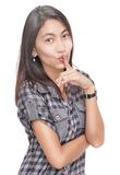 Hushing fashionable Asian girl Royalty Free Stock Photos