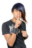 Hushing punk Asian teen Royalty Free Stock Photo