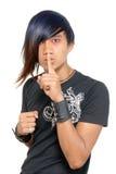 Hushing punk Asian teen Royalty Free Stock Photos