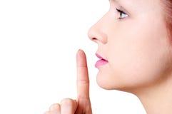 Hushing woman close up Stock Photo