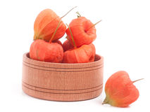 Husk tomatoes in wooden bowl isolated on white background Royalty Free Stock Photography