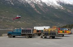 Sled dogs and apparatus waiting to be transported to a glacier for the summer tourist season Stock Photo