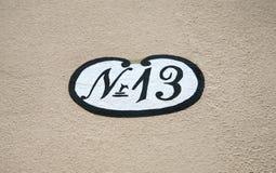 husnummer för 13 antikvitet Arkivfoto