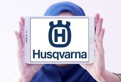 Husqvarna company logo. Logo of Husqvarna company on samsung tablet holded by arab muslim woman. Husqvarna is a manufacturer of outdoor power products including Stock Image