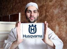 Husqvarna company logo. Logo of Husqvarna company on samsung tablet holded by arab muslim man . Husqvarna is a manufacturer of outdoor power products including Royalty Free Stock Photos