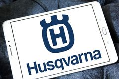 Husqvarna company logo. Logo of Husqvarna company on samsung tablet. Husqvarna is a manufacturer of outdoor power products including chainsaws, trimmers Stock Photo