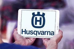 Husqvarna company logo. Logo of Husqvarna company on samsung tablet . Husqvarna is a manufacturer of outdoor power products including chainsaws, trimmers Stock Photos