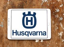 Husqvarna company logo. Logo of Husqvarna company on samsung tablet on wooden background. Husqvarna is a manufacturer of outdoor power products including Royalty Free Stock Image