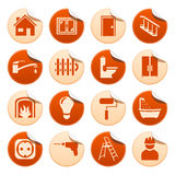 Husreparationsklistermärkear Arkivbild