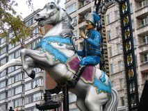 Fairground with hussar in blue. Hussar on a white horse at the fairground in Liege Royalty Free Stock Photo